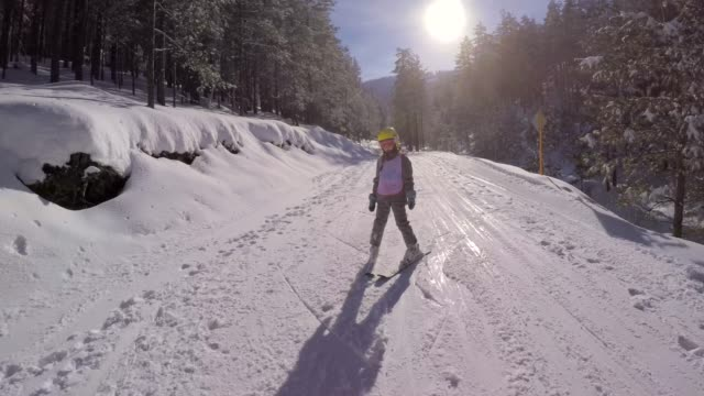 little girl learn to ski with ski instructor - ski stock videos & royalty-free footage
