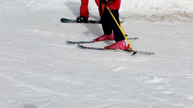 Little girl learning skiing