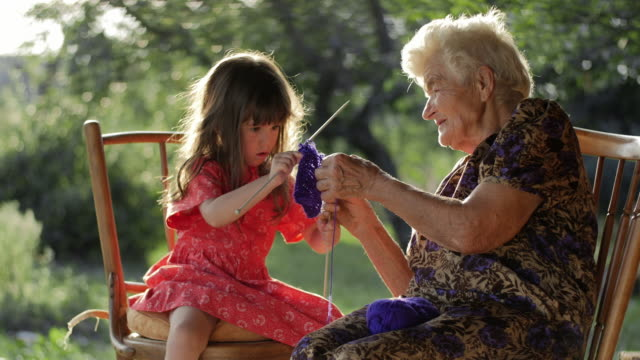 a little girl learning to knit from her grandmother - over 80 stock videos and b-roll footage