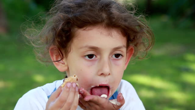 little girl licking melted ice cream from the hand - messy stock videos & royalty-free footage