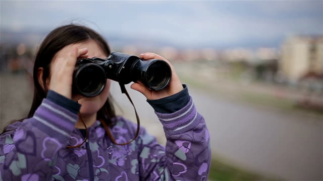 little girl looking through binoculars - binoculars stock videos & royalty-free footage