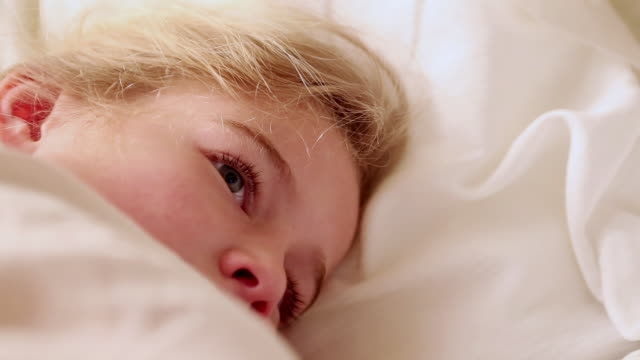 ms little girl lying awake in her bed / lamy, new mexico, united states - wohnraum stock-videos und b-roll-filmmaterial