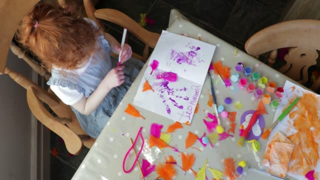 little girl making an easter card - messy stock videos & royalty-free footage