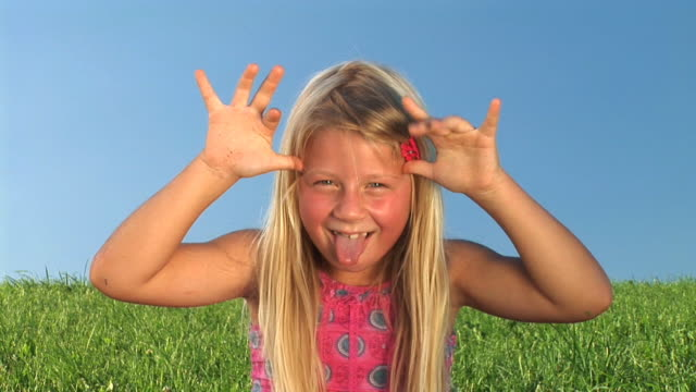 hd: little girl making faces - sticking out tongue stock videos & royalty-free footage