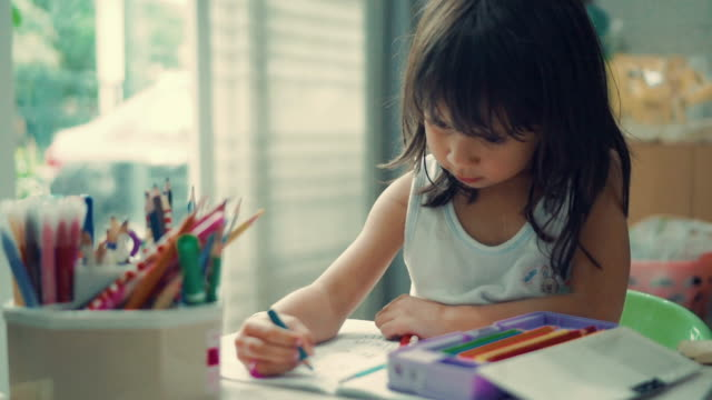 a little girl making her homework - mixed race person stock videos & royalty-free footage