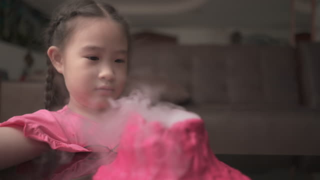 little girl making volcano for learning science at home. homeschool - volcano stock videos & royalty-free footage