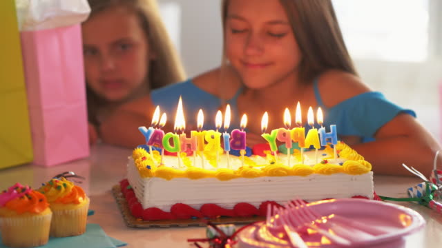little girl making wish at birthday party. - birthday cake stock videos & royalty-free footage