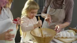 Little Girl Mixing Ingredients for Dough
