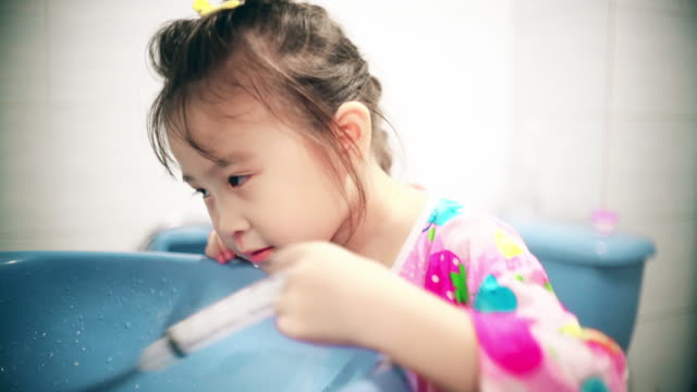 little girl nasal cleaning in bathroom - washing stock videos & royalty-free footage