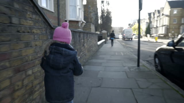 little girl on a push scooter - woolly hat stock videos and b-roll footage