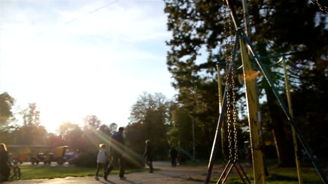 little girl on a swing, autumn - elementary school stock videos and b-roll footage