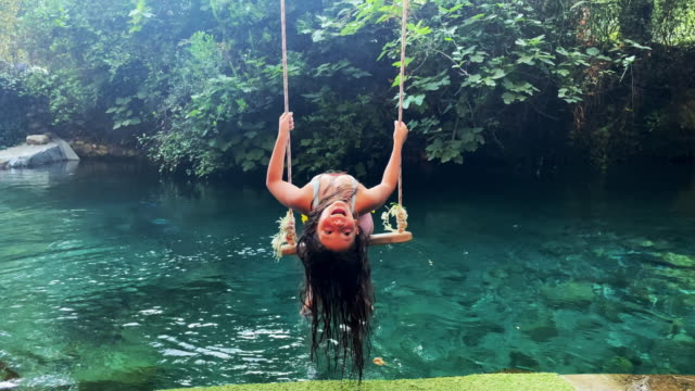 little girl on a swing by the river - one teenage girl only stock videos & royalty-free footage