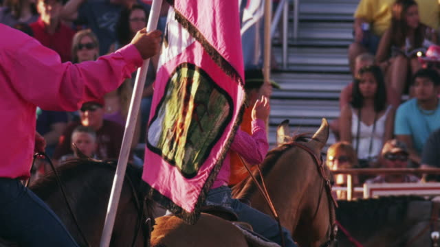 little girl on her horse with a group perform a routine at a rodeo while spectators watch - shot in slow motion. - 1 minute or greater stock videos & royalty-free footage