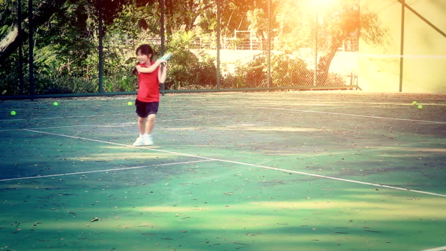 Little girl on the tennis court