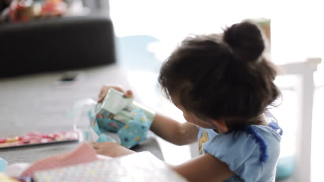 a little girl opening gift box. - wrapping paper stock videos & royalty-free footage