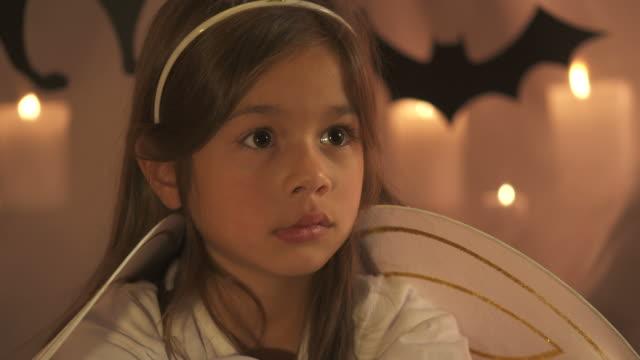 HD: Little Girl Participating In Halloween Workshop