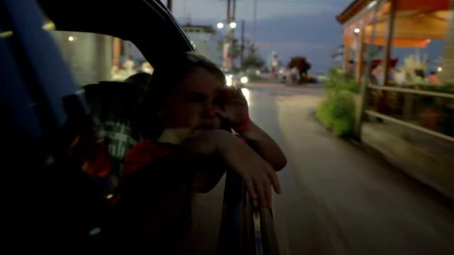 little girl peeking through the window - endast flickor bildbanksvideor och videomaterial från bakom kulisserna