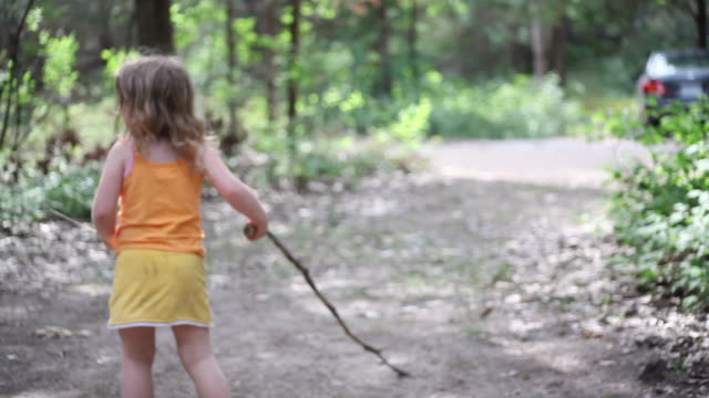 ms little girl performs dramatic play while using stick as character and little boy joining her / toronto, ontario, canada - kelly mason videos stock-videos und b-roll-filmmaterial