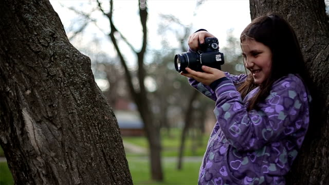 little girl photographing with digital camera - human face photos stock videos & royalty-free footage