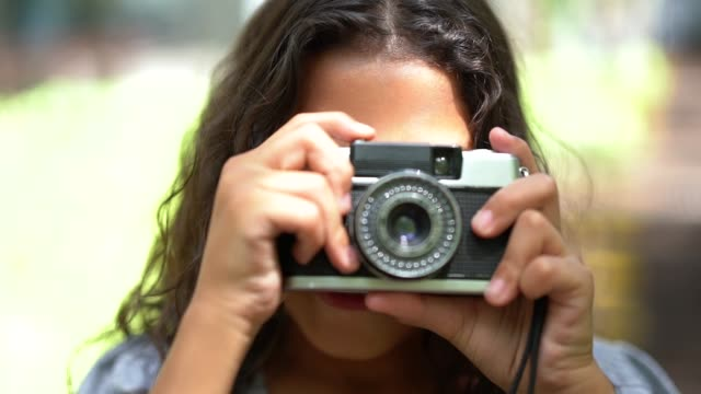 little girl photographing with retro camera - photography stock videos & royalty-free footage