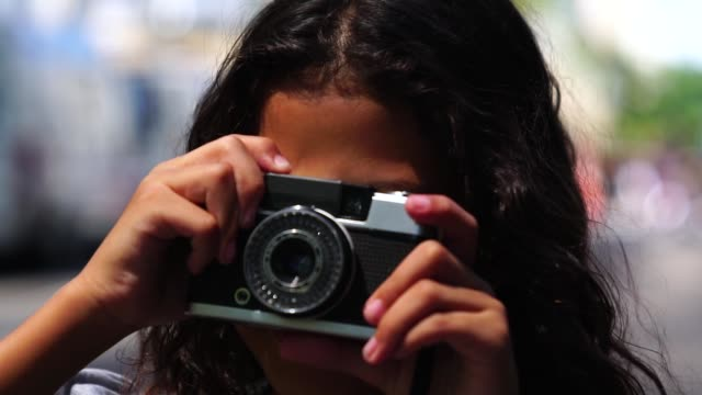 little girl photographing with retro camera - pardo brazilian stock videos & royalty-free footage
