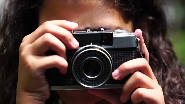 little girl photographing with retro camera - fotografo video stock e b–roll