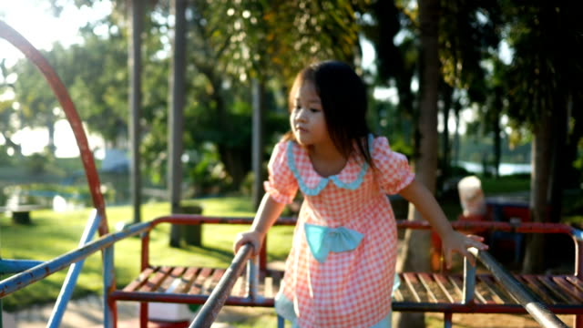 little girl play on the playground