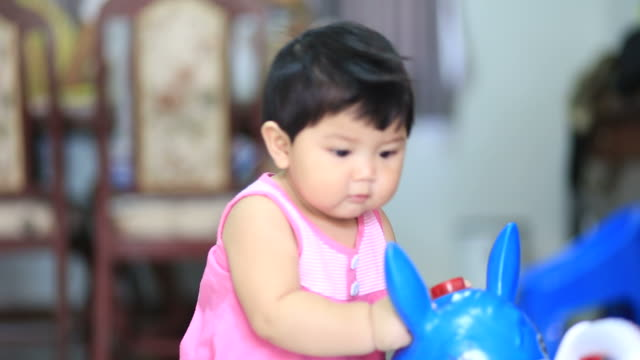 little girl play toy
