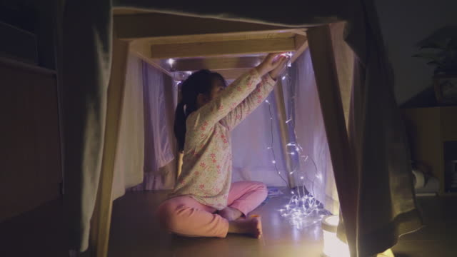 little girl playing and making a house tent in the room. - lantern stock videos & royalty-free footage