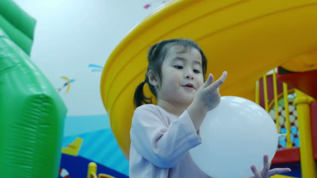 little girl playing ball in playground room , victory sign - concentration stock videos & royalty-free footage