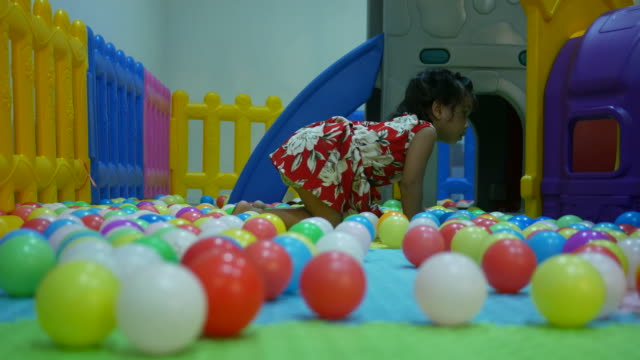 little girl playing ball in playground room - only girls stock videos and b-roll footage