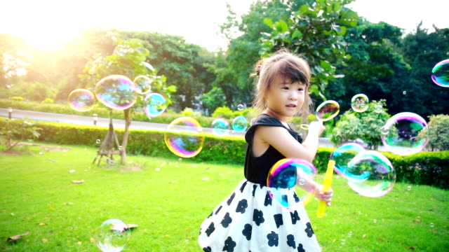 little girl playing bubbles slow motion - bubble stock videos & royalty-free footage