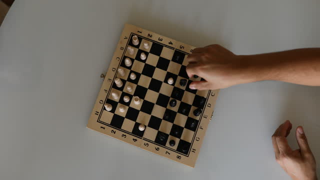 little girl playing chess with her father - dia stock videos & royalty-free footage