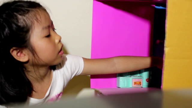 little girl playing dollhouse - dollhouse stock videos & royalty-free footage