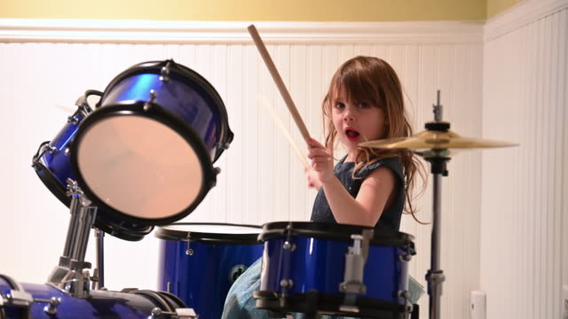 little girl playing drum - drum percussion instrument stock videos & royalty-free footage