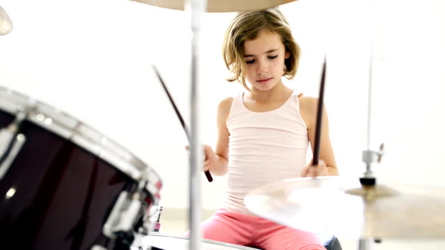 little girl playing drums - drum percussion instrument stock videos & royalty-free footage