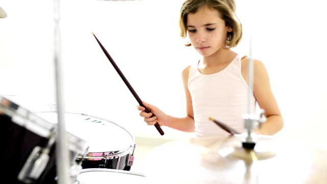 little girl playing drums - confidence stock videos and b-roll footage