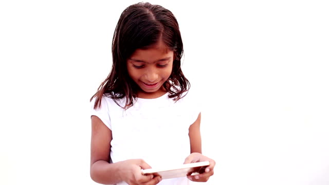 little girl playing games on smart phone - small stock videos & royalty-free footage