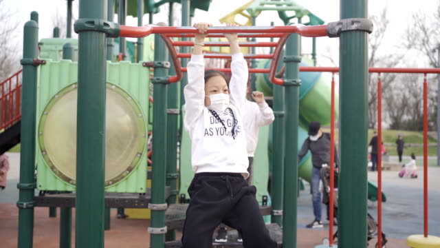 little girl playing in playground - messing about stock videos & royalty-free footage