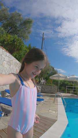 little girl playing in the resort swimming pool. - one girl only stock videos & royalty-free footage