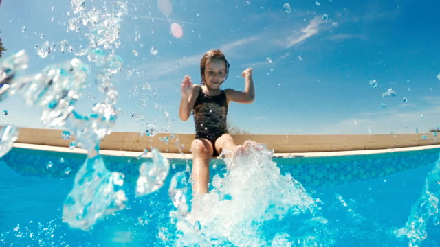 little girl playing in the resort swimming pool - baby girls stock videos & royalty-free footage