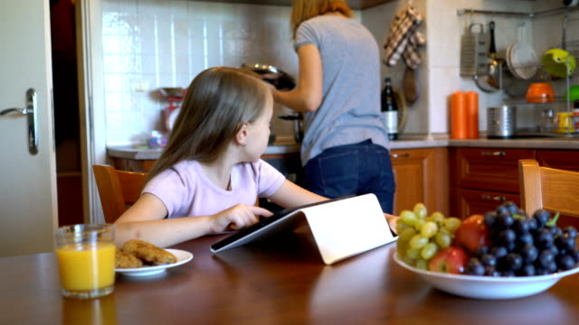 little girl playing on her digital tablet at home. - surfing the net stock videos & royalty-free footage