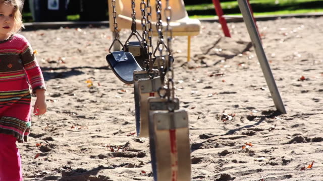 ms little girl playing  on swing in park / toronto, ontario, canada - kelly mason videos stock videos & royalty-free footage