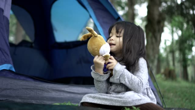 little girl playing rabbit doll during camping in the forest - doll stock videos and b-roll footage