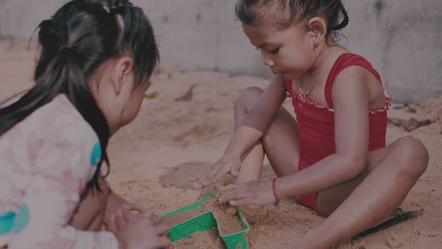 little girl playing sand and sea - pacific ocean stock videos & royalty-free footage