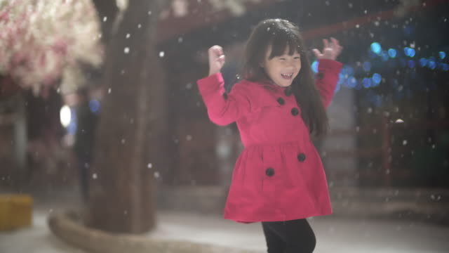 little girl playing snow - joy stock videos & royalty-free footage
