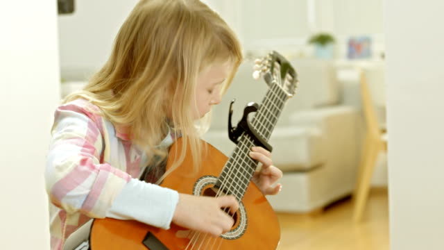 Little Girl Playing The Guitar