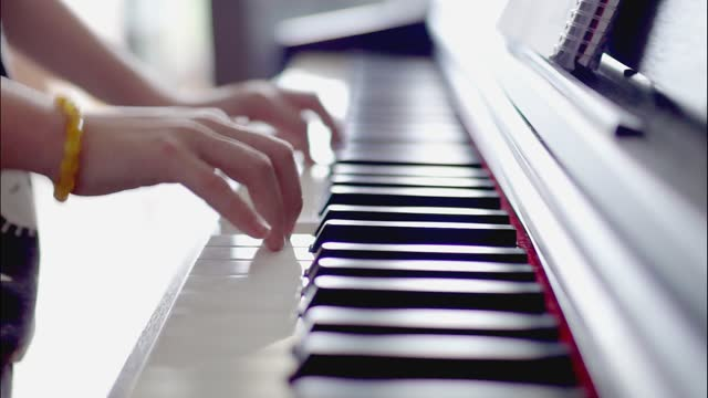 little girl playing the piano - 8 9 years stock videos & royalty-free footage