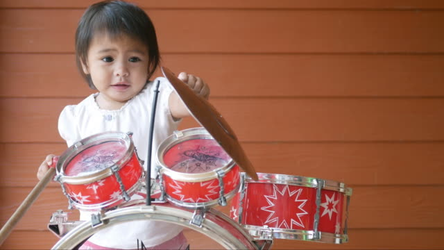 little girl playing toy , mini drum - drum percussion instrument stock videos & royalty-free footage