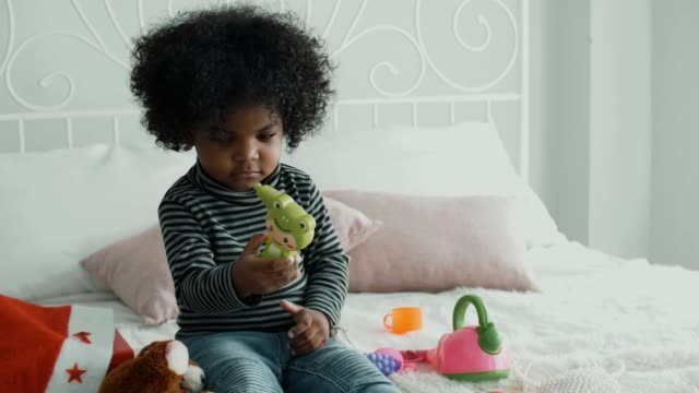 little girl playing toy on bed - baby girls stock videos & royalty-free footage